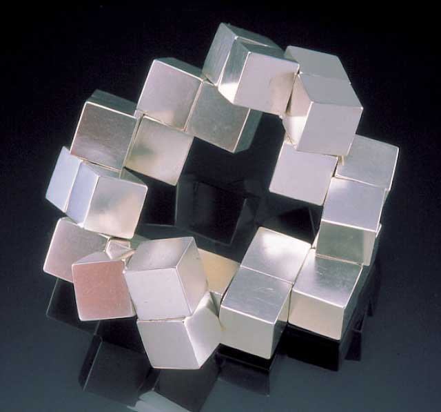 Submission by Alan Revere for the 1999 puzzle American Jewelry Design Council Project