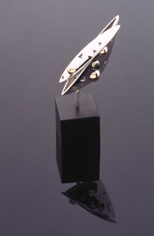 Submission by John Atencio for the 1996 cube American Jewelry Design Council Project