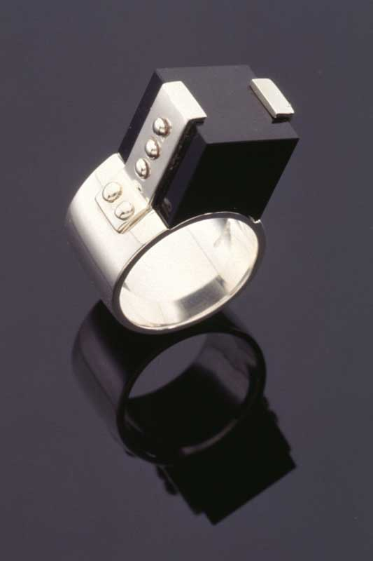 Submission by Jose Hess for the 1996 cube American Jewelry Design Council Project