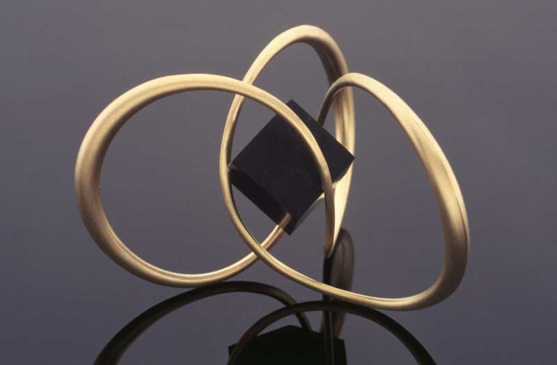 Submission by Michael Good for the 1996 cube American Jewelry Design Council Project