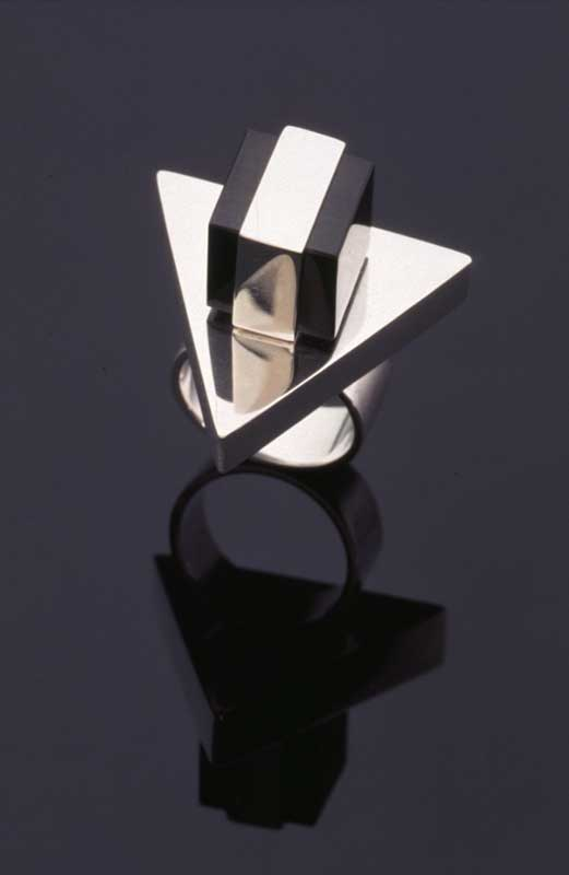 Submission by Sandy Baker for the 1996 cube American Jewelry Design Council Project