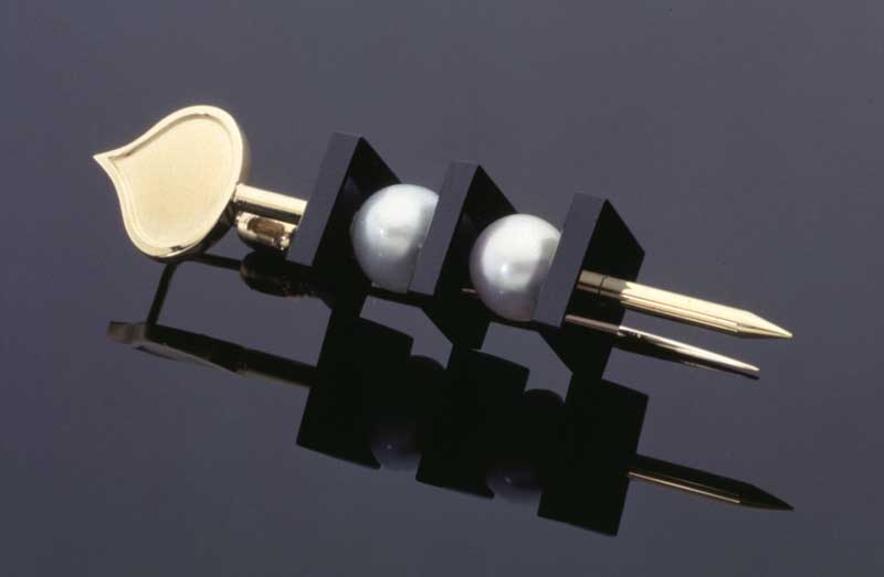 Submission by Susan Sadler for the 1996 cube American Jewelry Design Council Project